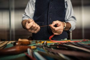 Artisan working with leather.